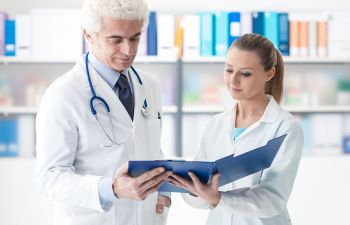 Doctors Reviewing Medical Files,